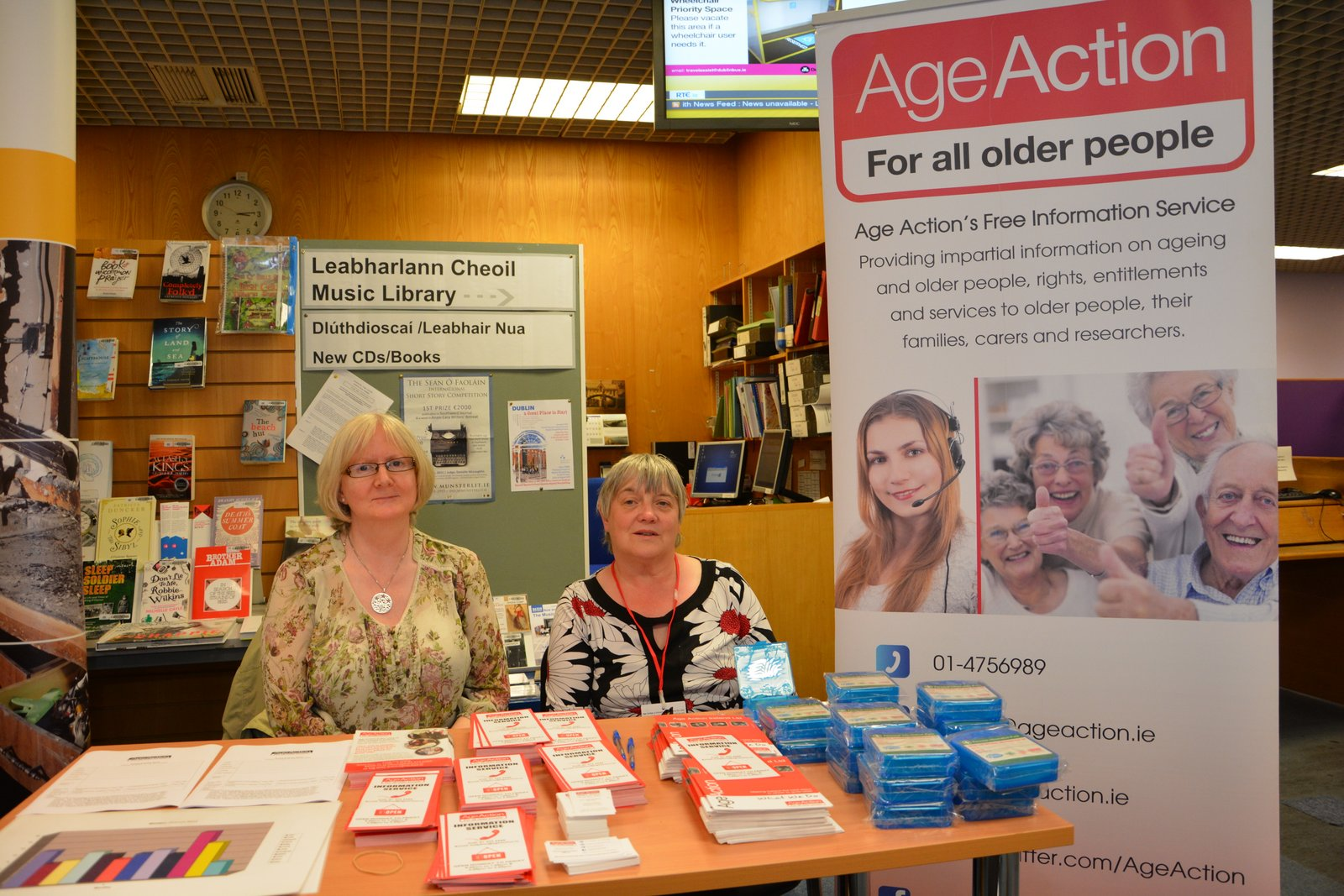 Information team stand in a local library.