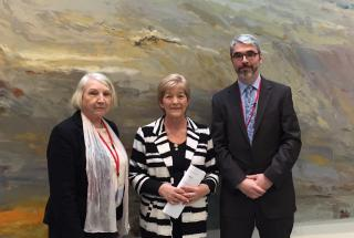 Age Action member Angela Gallagher with Deputy Anne Ferris and Justin Moran at committee hearings into mandatory retirement.