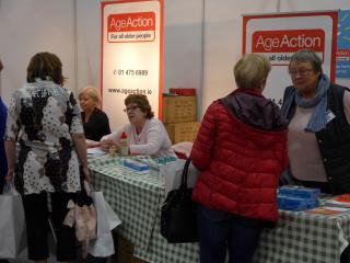 Age Action staff and volunteers running a busy information stand at the Over 50s Show.