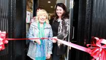Age Action Deputy Chief Executive Lorraine Fitzsimons holds the ribbon for customer June Smyth